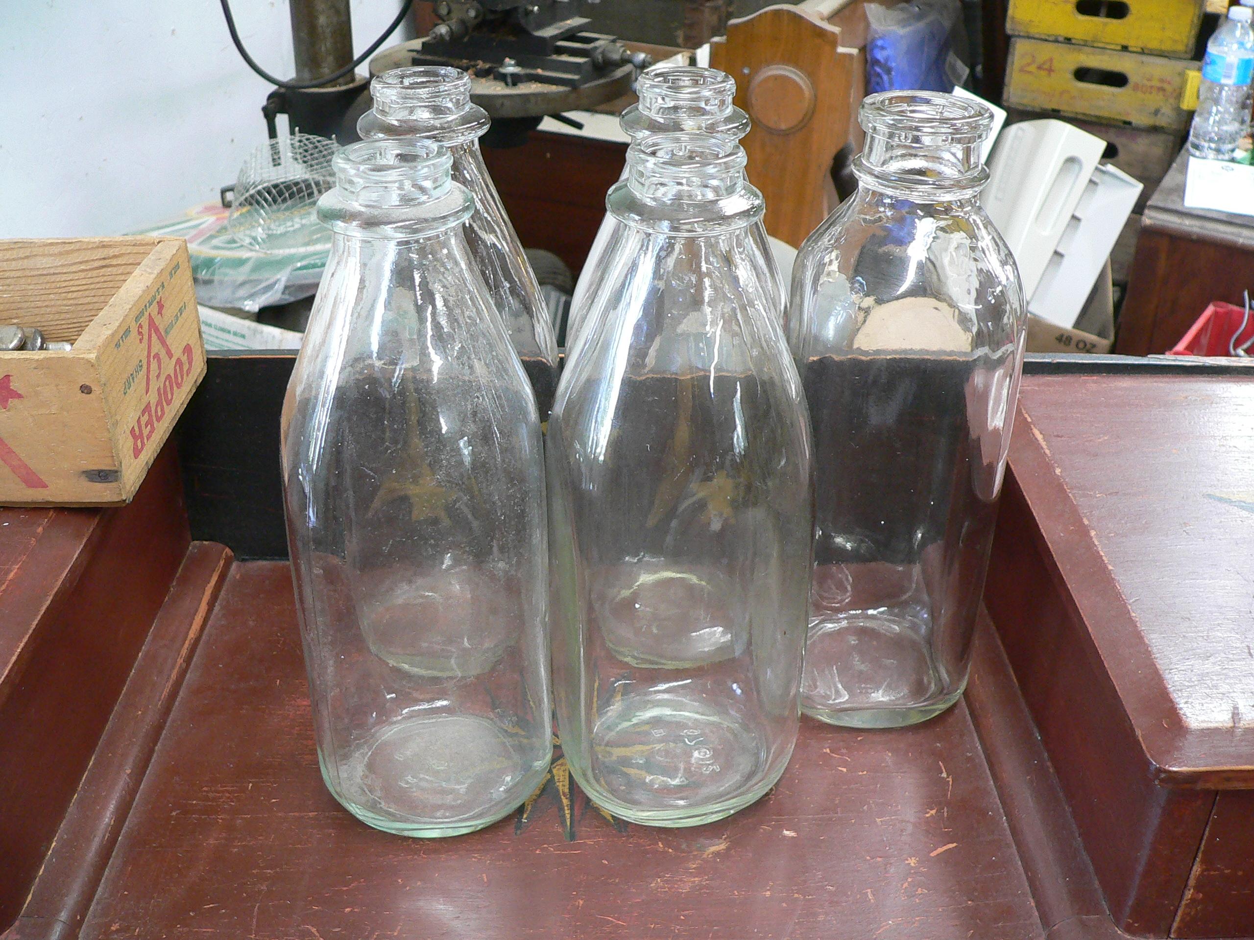 Plusieurs bouteille antique de lait # 5538